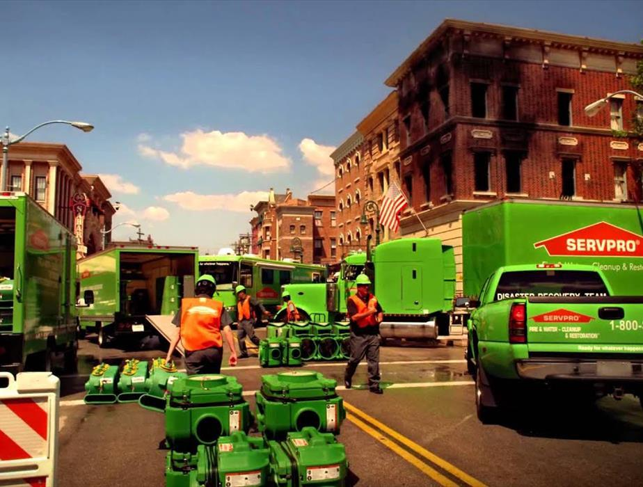 City background with SERVPRO workers.